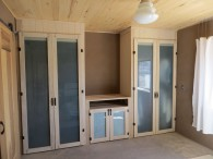 Bedroom closets are solid wood with milk paint finish and glass in doors.