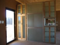 Foyer cabinets are aluminum frames with tempered glass panels and shelves.