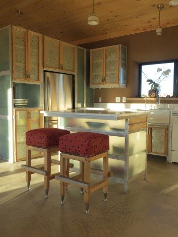 The kitchen cabinets are aluminum frames with tempered glass panels and tempered glass shelves.