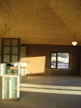 The main room with the kitchen, dining room and livingroom.  The ceiling follows the roofline.  Tongue and groove aspen ceiling was sealed with 3 coats of AFM Safeseal.