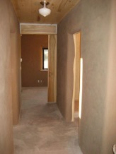 Natural plaster walls are earth, sand, and water mixed on site.